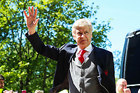 Arsene Wenger waves at fans as he steps off the team coach before his final game in charge of Arsenal during the Premier League match between Huddersfield Town and Arsenal at the John Smith's Stadium, Huddersfield, England on 13 May 2018. Photo by Thomas Gadd / PRiME Media Images.