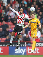 Preston North End's Ben Davies jumps with Sheffield United's David McGoldrick<br /> <br /> Photographer Mick Walker/CameraSport<br /> <br /> The EFL Sky Bet Championship - Sheffield United v Preston North End - Saturday 22 September 2018 - Bramall Lane - Sheffield<br /> <br /> World Copyright &copy; 2018 CameraSport. All rights reserved. 43 Linden Ave. Countesthorpe. Leicester. England. LE8 5PG - Tel: +44 (0) 116 277 4147 - admin@camerasport.com - www.camerasport.com