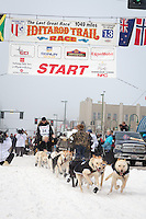 Justin Savidis and team leave the ceremonial start line at 4th Avenue and D street in downtown Anchorage during the 2013 Iditarod race. Photo by Jim R. Kohl/IditarodPhotos.com