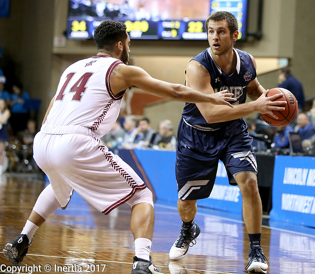 SIOUX FALLS, SD: MARCH 22: Luke Schroepfer #30 from Colorado Mines looks to make a move past Tyler Jenkins #14 from Bellarmine during the Men's Division II Basketball Championship Tournament on March 22, 2017 at the Sanford Pentagon in Sioux Falls, SD. (Photo by Dave Eggen/Inertia)