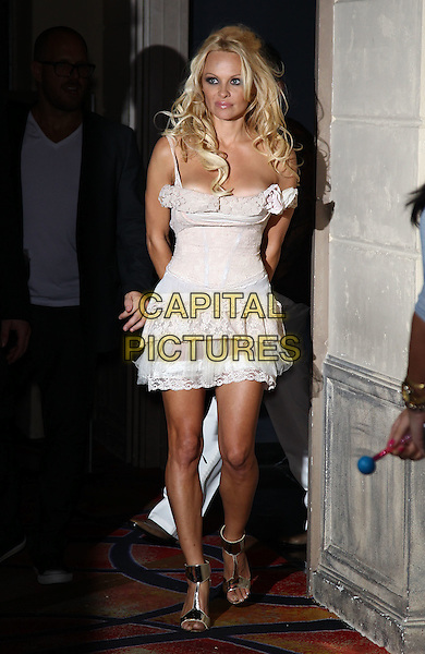 Pamela Anderson.celebrates her birthday at Chateau Nightclub inside Paris Las Vegas, Las Vegas, Nevada, USA, 30th July 2011..full length white dress  lace cream tiered ruffles  silver gold t-bar shoes sandals  open toe ankle strap peach .CAP/ADM/MJT.© MJT/AdMedia/Capital Pictures.