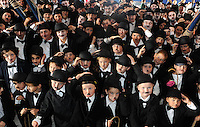 24-8-2014 Hats Off to the 'proper charlies' as they line up to be counted for the world record attempt for the most Charlie Chaplin lookalikes in one place at the Charlie Chaplin Festival in Waterville, County Kerry on Sunday.<br /> Picture by Don MacMonagle
