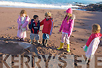 ANOTHER: Siobha?n Ni? Laighin, Justin Lucas, Eoghan O? Laighin, Muireann Ni? Chathasaigh looking at yet another dolphin washed ashore this time in Ballyguin, Brandon.   Copyright Kerry's Eye 2008