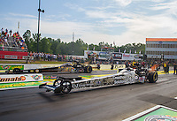 May 17, 2015; Commerce, GA, USA; NHRA top fuel driver Larry Dixon (near lane) races alongside Tony Schumacher during the Southern Nationals at Atlanta Dragway. Mandatory Credit: Mark J. Rebilas-USA TODAY Sports