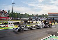 May 17, 2015; Commerce, GA, USA; NHRA top fuel driver Larry Dixon (near lane) races alongside Tony Schumacher during the Southern Nationals at Atlanta Dragway. Mandatory Credit: Mark J. Rebilas-USA TODAY Sports