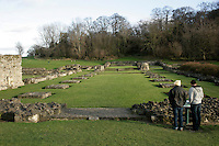 Reading the sign for Lesnes Abbey in Abbeywood, southeast London, UK