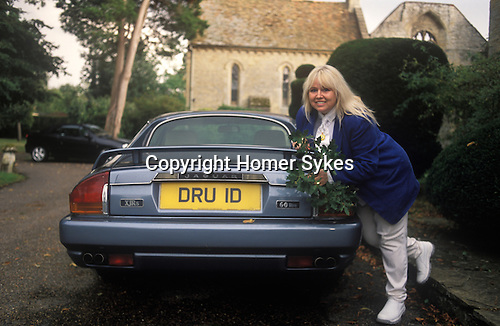 Dwina Gibb, widow of Robin Gibb of the pop group Dwina Bee Gees, with her personalised number  DRU ID. Dwina is holding oak leaves and is a well know Druid. Taken at their family home in the Home Counties.