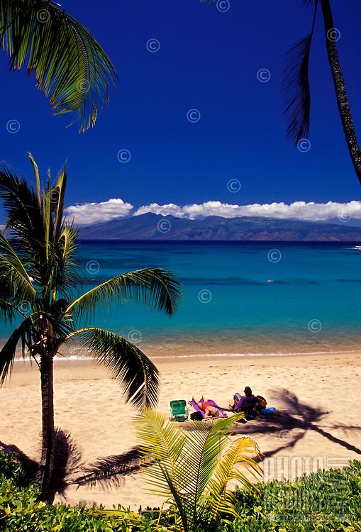 People enjoy a day at Napili Bay, Maui.
