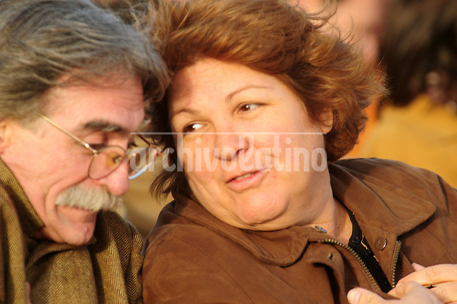 """Aleida Guevara, daughter of revolutionary   Ernesto """"Che"""" Guevara , speaks with his uncle, Che's younger brother Juan Martin,  during the inauguration of a statue at the  birthplace of her father in Rosario, the first such monument to the revolutionary in his homeland."""