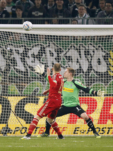21.03.2012.  Moenchengladbach, Germany.  DFB Cup Semi-finals Borussia Moenchengladbach versus FC  Bayern  Munich Arjen Robben  shoots the Ball but it is headed over the bar