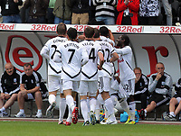 Pictured: Leroy Lita of Swansea mobbed by team mates celebrating his goal. Saturday 17 September 2011<br /> Re: Premiership football Swansea City FC v West Bromwich Albion at the Liberty Stadium, south Wales.