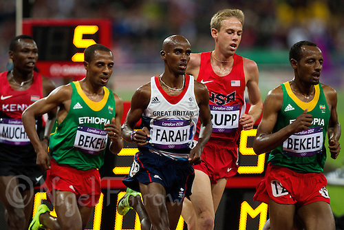 04 AUG 2012 - LONDON, GBR - Mo Farah (GBR) of Great Britain (third from right) runs in the lead pack alongside his training partner Galen Rupp (USA) of the USA (second from right) during the men's 10,000m final at the London 2012 Olympic Games athletics at the Olympic Stadium in the Olympic Park, Stratford, London, Great Britain.(PHOTO (C) 2012 NIGEL FARROW)