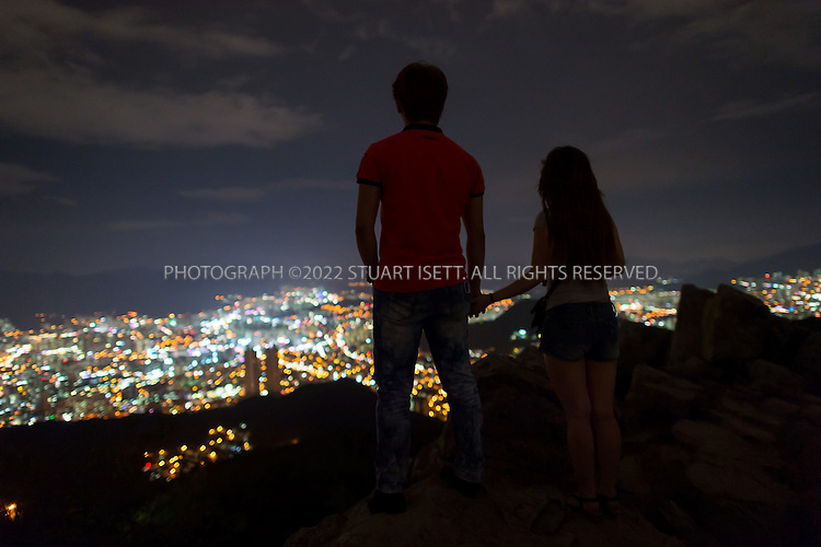 9/3/2013--Busan, South Korea<br /> <br /> Visitors enjoy the Hwangryeongsan mountain night view in Busan (Pusan).<br /> <br /> Photograph by Stuart Isett<br /> &copy;2013 Stuart Isett. All rights reserved.