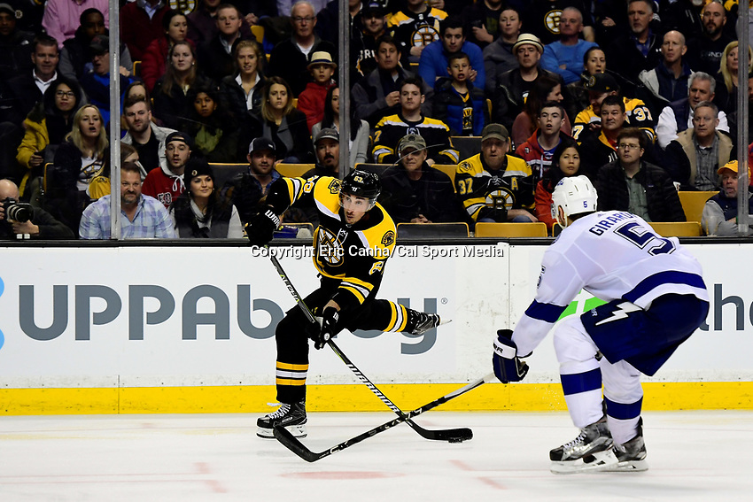 March 29, 2018: Boston Bruins left wing Brad Marchand (63) tees up a shot at the net during the NHL game between the Tampa Bay Lightning and the Boston Bruins held at TD Garden, in Boston, Mass. Boston defeats Tampa Bay 4-2. Eric Canha/CSM