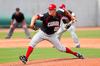 Jay Johnson #20 of the Canadian World Cup/Pan Am Team in action against Team USA at the USA Baseball National Training Center on September 28, 2011 in Cary, North Carolina.  (Brian Westerholt / Four Seam Images)
