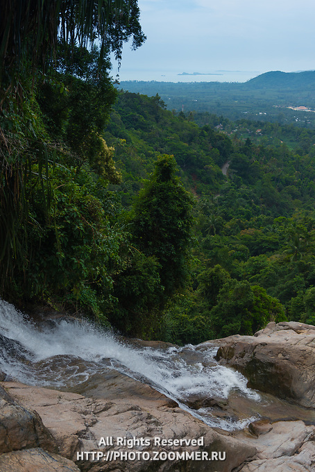 Panorama of upper Namuang waterfall, water running down the rocks, Samui, Thailand