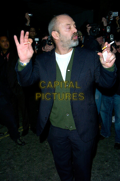 KEITH ALLEN.The Brit Awards 2007 Oasis after party, Cuckoo Bar & Nightclub, London, UK..February 14th, 2007.brits half length blue pinstripe suit smoking cigarette hands match gesture.CAP/CAN.©Can Nguyen/Capital Pictures