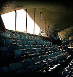 "From Wikipedia:..The Miami Marine Stadium located on the Virginia Key was the first purpose built stadium for powerboat racing in the United States. The 7,500 seat stadium was built in 1963 on land donated by the Matheson family for ""Water Sports""..The Stadium was host for many world class powerboat events including Unlimited Hydroplane, Inboard, Outboard, Performance Craft, Stock, Modified, Grand National divisions as well as other special event races. The Stadium was also the site of a number of nationally televised events including the Bill Muncey Invitational and the ESPN All American Challenge Series. The last major race in the Stadium was the 1987 Inboard Hydroplane national Championship..The Stadium utilized a floating stage in front of the grandstand for diverse activities such as classical concerts, Rock and Roll shows and the annual Easter Sunrise Service..Due to restrictions in use, political pressures from within the City of Miami, and the lack of proper promotion the Stadium saw a gradual decline in events. At the same time the City leased much of the Stadium grounds to numerous ventures including the Miami Rowing Club, and various marinas and restaurants. This created an atmosphere not conducive to the original intent of the Stadium, namely powerboat racing. Numerous proposals were floated before the Miami City Commission throughout the 1980s to no avail. One drawback was the restriction the Matheson family placed upon the Stadium when the land was donated for its construction. By the early 1990s powerboat racing in the Stadium was in reality only a memory..In 1992 Hurricane Andrew struck the Miami/Dade County area. Engineers for the City condemned the structure. Other independent engineers declared the structure sound although needing refurbishing. Since that time the Stadium has been allowed to sit with no attempt at maintenance. Vandalism has been great at the Stadium since the hurricane..The stadium is a breeding ground now for many of Miami's graf"