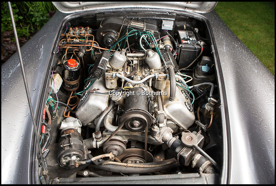 BNPS.co.uk (01202 558833)<br /> Pic: Bonhams/BNPS<br /> <br /> 2.5 litre V8 engine.<br /> <br /> Ahead of its time - revolutionary British invention from the swinging sixties that first put the wind in your hair.<br /> <br /> This unique Daimler sports car from 1963 features the worlds first electric roof - that enabled motorists to open up the roof even when travelling at 100 mph.<br /> <br /> The 1960 Daimler SP250 is a one-off prototype and was 30 years ahead of its time - the first car to have a working retractable roof after more than 5,000 man hours and £30,000 were spent on it.<br /> <br /> It has been in the same family for 56 years since it was bought new and is now being sold at Bonhams Goodwood Revival on September 10 with a £70,000 estimate.