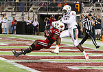 Louisville Cardinals wide receiver DeVante Parker (9) pulls in a touchdown against  Miami Hurricanes defensive back Artie Burns (1) as the Louisville Cardinals played the Miami Hurricanes in the Russell Athletic Bowl in Orlando, Fl. on December 28, 2013.  Photo by Mark Mahan
