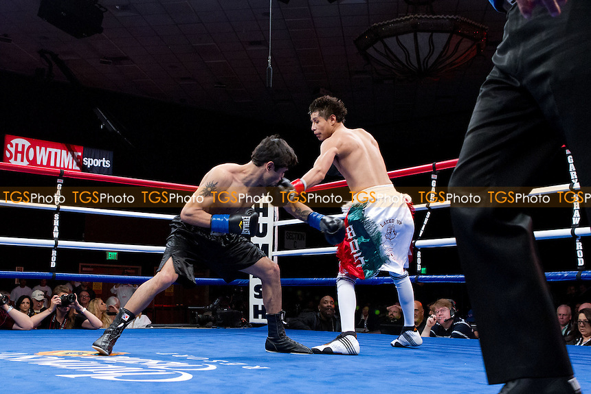 "Rufino ""El Animale"" Serrano (11-3-0, 0 KOs) from Santa Maria, California, in white/red/green shorts defeated Rodrigo Aranda (8-16-2, 2 KOs) from Tabasca, Mexico, in black shorts in a six round Featherweight bout by a unanimous decision - ShoBox: The New Generation (Showtime network) at the Chumash Casino Resort in Santa Ynez, California, produced by Gary Shaw Productions - 17/2/12 - Dwight McCann/TGSPHOTO - Self billing applies where appropriate - 0845 094 6026 - contact@tgsphoto.co.uk - NO UNPAID USE"