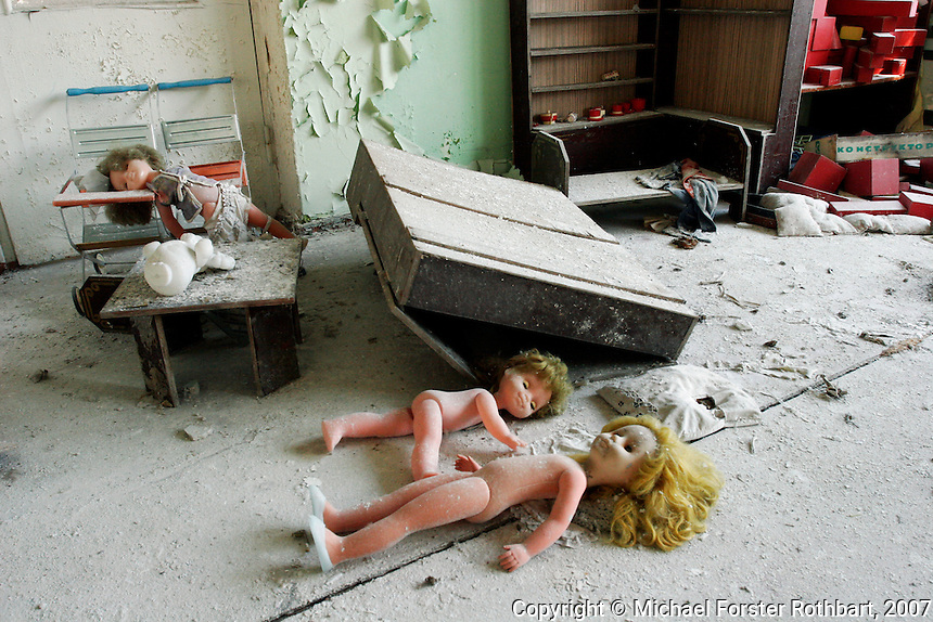 &ldquo;I only went back once. I couldn&rsquo;t stop crying.&rdquo;<br /> &mdash; Galina  Dondukova, former Pripyat kindergarten director<br /> <br /> Dolls lay scattered on a classroom floor of the Solntsye kindergarten in Pripyat, the abandoned city one mile from the Chernobyl nuclear power plant. A closed Soviet city with population 49,360, Pripyat was built to house workers at Chernobyl. <br /> <br /> Today Pripyat is an eerie ghost town. Any valuables have long-since been stolen, but the toys remain.<br /> ------------------- <br /> This photograph is part the book of Would You Stay?, by Michael Forster Rothbart, published by TED Books in 2013. The photos come from Forster Rothbart&rsquo;s two long-term documentary photography projects, After Chernobyl and After Fukushima.<br /> &copy; Michael Forster Rothbart 2007-2013.<br /> www.afterchernobyl.com<br /> www.mfrphoto.com &bull; 607-267-4893 &bull; 607-436-2856<br /> 34 Spruce St, Oneonta, NY 13820<br /> 86 Three Mile Pond Rd, Vassalboro, ME 04989<br /> info@mfrphoto.com<br /> Photo by: Michael Forster Rothbart<br /> Date:  4/2007    File#:  Canon 20D digital camera frame 4139<br /> -------------------