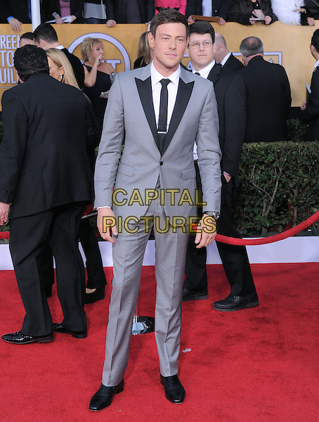 Corey Monteith.Arrivals at the 19th Annual Screen Actors Guild Awards at the Shrine Auditorium in Los Angeles, California, USA..27th January 2013.SAG SAGs full length black grey gray suit white shirt lapels .CAP/DVS.©DVS/Capital Pictures.