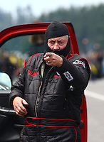 Aug. 2, 2014; Kent, WA, USA; NHRA top fuel dragster driver Ron Smith during qualifying for the Northwest Nationals at Pacific Raceways. Mandatory Credit: Mark J. Rebilas-
