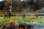 Johnny Bowling burns out dry grass in a ditch by his driveway with his sons Nate, 4, and Nick (right), 2, at their home on Pistol Creek Road. near London, Ky. Burning the brush helps prevent snakes and cleans the area for the upcoming winter.