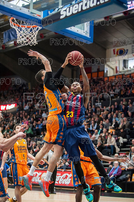 VALENCIA, SPAIN - MARCH 5: Deshaun Thomas, Lucic and Sam Van Brossom during EURO CUP match between Valencia Basket Club and Bascelona F.C. Basket at Fonteta Stadium on March 22, 2015 in Valencia, Spain