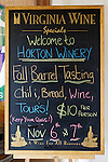A hand-drawn blackboard sign welcomes visitors and announces upcoming events at Horton Vineyards.