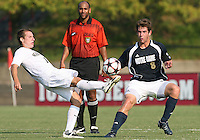 04 September 2009:Michael Thomas #8 of the University of Notre Dame watches Corben Bone #10 of Wake Forest University hook the ball during an Adidas Soccer Classic match at the University of Indiana in Bloomington, In. The game ended in a 1-1 tie..