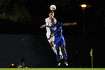 17 October 2014: Notre Dame's Matt Habrowski (4) heads the ball over Duke's Jeremy Ebobisse (19). The Duke University Blue Devils hosted the Notre Dame University Fighting Irish at Koskinen Stadium in Durham, North Carolina in a 2014 NCAA Division I Men's Soccer match. Notre Dame won the game 4-1.