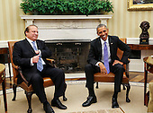 United States President Barack Obama (R) holds a bilateral meeting with Prime Minister Nawaz Sharif (L) of Pakistan in the Oval Office of the White House, in Washington, DC, October 22, 2015.<br /> Credit: Aude Guerrucci / Pool via CNP