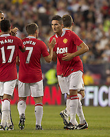 Manchester United FC forward Federico Macheda (27) celebrates his goal with teammates. In a Herbalife World Football Challenge 2011 friendly match, Manchester United FC defeated the New England Revolution, 4-1, at Gillette Stadium on July 13, 2011.