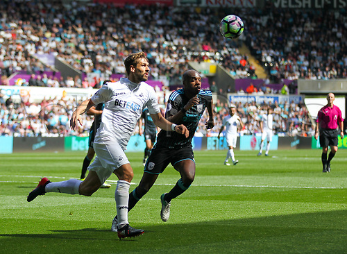 May 21st 2017, Liberty Stadium, Swansea Wales;  EPL Premier league football, Swansea versus West Bromwich Albion; Fernando Llorente of Swansea City (L) and Allan Nyom of West Bromwich Albion (R) chase a loose ball