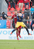 Toronto, Ontario - May 17, 2014: Toronto FC defender Nick Hagglund #17 and New York Red Bulls forward Bradley Wright-Phillips #99 in action during a game between the New York Red Bulls and Toronto FC at BMO Field. Toronto FC won 2-0.