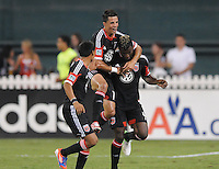 D.C. United midfielder Marcelo Saragosa (11) and defender Andy Najar (14) celebrates Brandon McDonald score in the 51th minute of the game. D.C. United defeated The Chicago Fire 4-2 at RFK Stadium, Wednesday August 22, 2012.