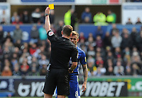 Referee Robert Jones shows the yellow card to Cardiff City's Joe Ralls<br /> <br /> Photographer Ian Cook/CameraSport<br /> <br /> The EFL Sky Bet Championship - Swansea City v Cardiff City - Sunday 27th October 2019 - Liberty Stadium - Swansea<br /> <br /> World Copyright © 2019 CameraSport. All rights reserved. 43 Linden Ave. Countesthorpe. Leicester. England. LE8 5PG - Tel: +44 (0) 116 277 4147 - admin@camerasport.com - www.camerasport.com