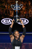 January 28, 2017: Serena Williams of United States pose for photos with the trophy after winning the Women's Final on day 13 of the 2017 Australian Open Grand Slam tennis tournament in Melbourne, Australia. Photo Sydney Low