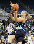 Foothill's Bri Higgins shoots over Reed defender Nyasha LeSure during a semi-final game in the NIAA 4A State Basketball Championships between Reed and Foothill high schools at Lawlor Events Center in Reno, Nev, on Thursday, Feb. 23, 2012. .Photo by Cathleen Allison
