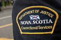 Department of Justice Nova Scotia badge is seen during a police memorial parade in Ottawa Sunday September 26, 2010.