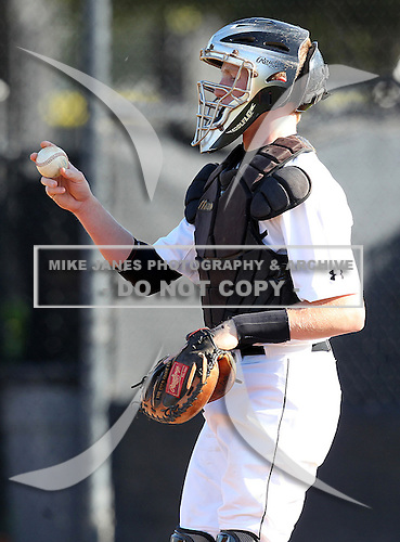 Pat Lien of the Olympia Titans varsity baseball team during a game against the Montverde Academy Eagles at Olympia High School on March 7, 2011 in Orlando, Florida.  (Copyright Mike Janes Photography)