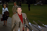 Washington, DC., USA, December 27, 1984<br /> President Ronald Reagan talks with reporters outside the South Portico entance as he and First Lady Nancy Reagan prepare to board Marine One for flight to Andrews AFB for trip to California. Credit: Mark Reinstein/MediaPunch