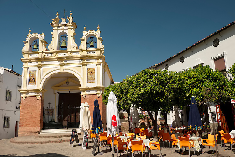 A sleepy, but colorful town square lazes in the morning sunshine, in the hill town of Zahara de la Sierra.