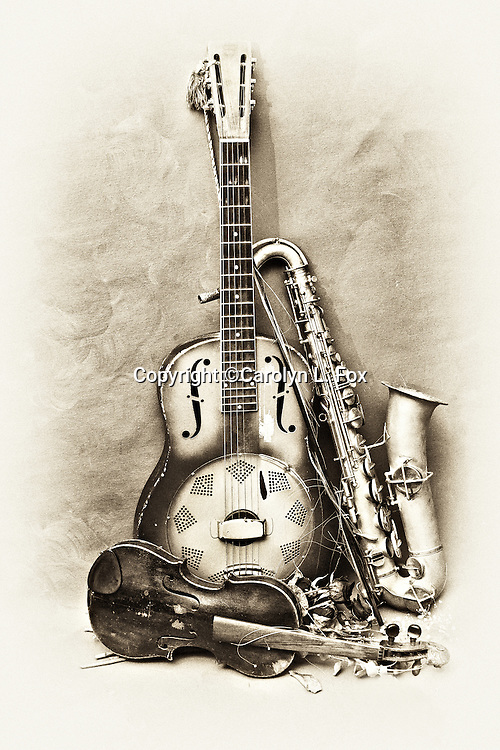 Antique musical instruments lean up against an old background.