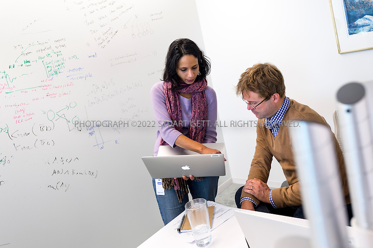 11/6/2014&mdash;Seattle, WA, USA<br /> <br /> Sumithra Bhakthavatsalam (left) Oyvind Tafjord (right) working at the Allen Institute for Artificial Intelligence.<br /> <br /> The Allen Institute for Artificial Intelligence (abbreviated AI2) is a research institute funded by Microsoft co-founder Paul Allen to achieve scientific breakthroughs by constructing AI systems with reasoning, learning and reading capabilities. Oren Etzioni was appointed by Paul Allen in September 2013 to direct the research at the institute<br /> <br /> Photograph by Stuart Isett<br /> &copy;2014 Stuart Isett. All rights reserved.
