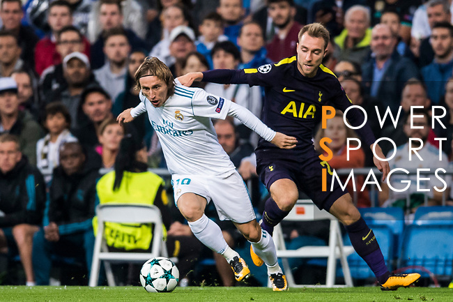 Luka Modric of Real Madrid  (L) fights for the ball with Christian Eriksen of Tottenham Hotspur FC (R) during the UEFA Champions League 2017-18 match between Real Madrid and Tottenham Hotspur FC at Estadio Santiago Bernabeu on 17 October 2017 in Madrid, Spain. Photo by Diego Gonzalez / Power Sport Images
