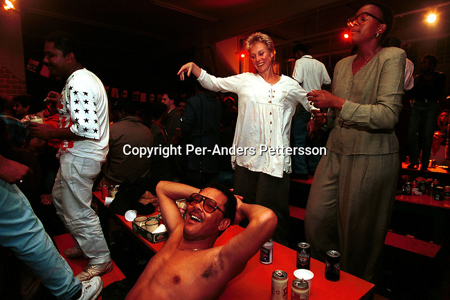 Unidentified people dancing in a music club as a live band is performing on February 12, 1997 in Rosebank a suburb in Johannesburg, South Africa. Johannesburg has the best nightlife in South Africa and is the home to many skilled Jazz players..(Photo: Per-Anders Pettersson/ Getty Images)