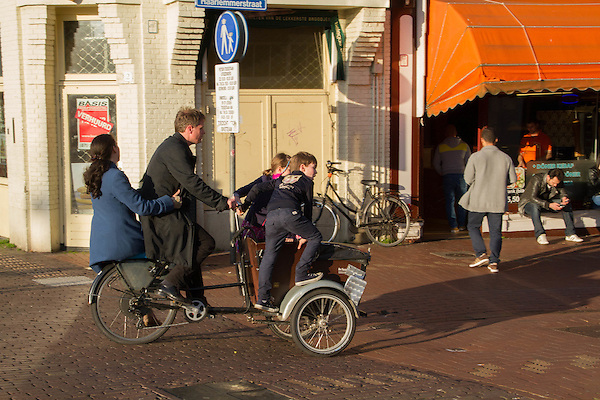 Family cycling in Leiden, Netherlands. .  John offers private photo tours in Denver, Boulder and throughout Colorado, USA.  Year-round. .  John offers private photo tours in Denver, Boulder and throughout Colorado. Year-round.